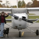 Michele McGuire with Cooper and her Skyhawk
